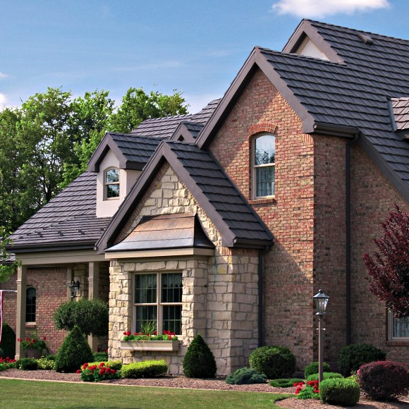 Because of aluminum's high emissivity and the highly reflective PVDF coating technology used by Classic Metal Roofing Systems, Country Manor Shake (pictured here in Mustang Brown) can save you up to 25% on your energy bills for the rest of your life.  The four-way interlocking panels will also withstand hurricane strength winds and hail.