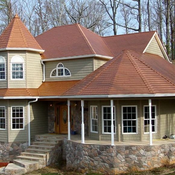 Kassel & Irons strives to take homeowners out of the recurring and vicious re-roofing cycle. KasselWood steel shingles (pictured here in Copper Penny) combine the beauty of traditional roofing with the strength of steel to create a magnificent, worry- free roof that lasts a lifetime.