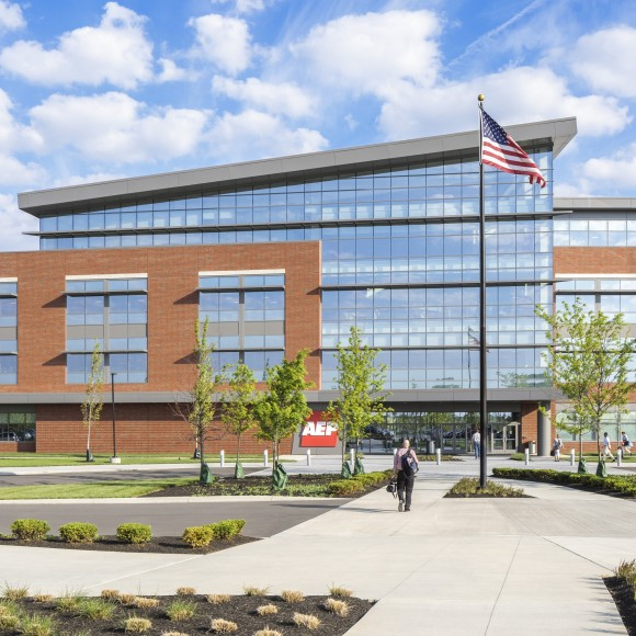 AEP Transmission Building - At the heart of this 195,000 sq. ft. building is a soaring four-story atrium. Bridges and a full height monumental stair crisscross this space visually connecting the floors.