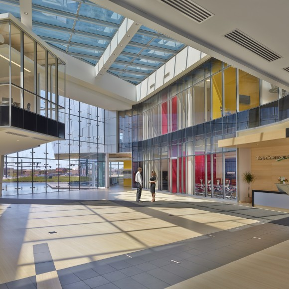 The Connor Group Headquarters - The play of sunlight on the building's aluminum skin is reflected both inward and outward to allow an artful expression of the building's textured surface.
