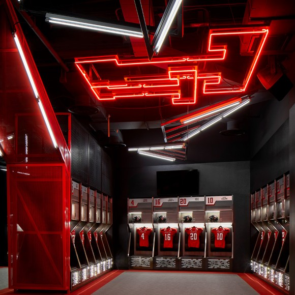 The Texas Tech Football program significantly upgraded its amenities with 120 steel lockers to go along with a new players' lounge, state-of-the-art lighting system and 60-inch HD televisions scattered throughout the facility. The locker room is also highlighted by a new entrance, featuring various Red Raider helmets as well as a lighted Double T hanging from the roof of the ceiling. In addition to the locker room, the adjacent weight room also received a face lift with a new workout mat and updated graphics along the exterior walls. Dror Baldinger