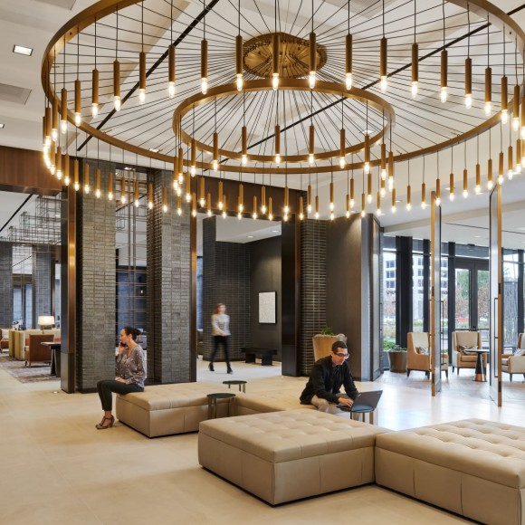 Marriott CityPlace Hotel at Springwoods Village is an 11-story hotel that includes a restaurant, bar, ballrooms, meeting spaces, fitness center, outdoor terraces and an adjacent 3-story pre-cast parking garage. The design team drew inspiration rooted from the railroad and lumber industry in Spring, Texas by using metal detailing throughout. Since the hotel is located in a pedestrian friendly environment that incorporates nature, we have done the same inside of the hotel. Peter Molick