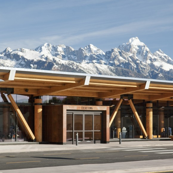 The Jackson Hole Airport distinguishes itself from the aesthetics of typical airports because of its regional design approach, materiality, and intimate scale. Internally the architecture, interior design, brand design and public art are all integrated to form a cohesive design. Matthew Millman