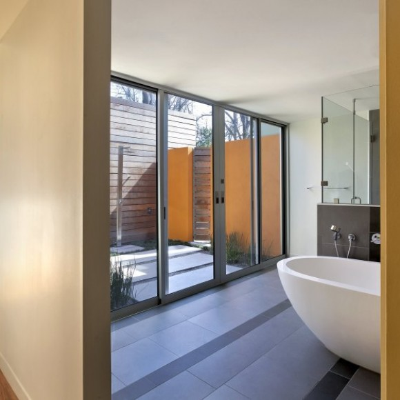 Under the Oak Tree: The master bedroom is flanked by a substantial master closet and a private courtyard equipped with an outdoor shower.  The master bath renovation – part of the original home - flows seamlessly into the courtyard.