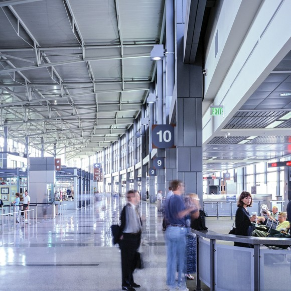 Austin-Bergstrom International Airport reflects the nature of Austin without creating an empty pastiche. The design references Austin-style elements like blackened steel, wood, and elegant forms for new retail typologies mixed with urban-style finishes like etched glass and sleek lighting accents. Local street art was incorporated into the design through printed panels in restroom corridors, millwork that doubles as large art display cases, and advertising areas. Dror Baldinger