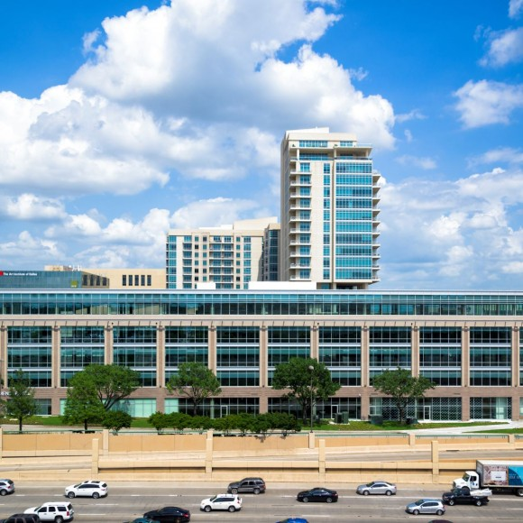 A five-story horizontal tower with street-level retail and high-performance glass façade has sweeping views of the public green plaza inThe Shops at Park Lane development. Strategically placed, the LEED-registered Silver office building naturally shields the interior of the marketplace from highway noise and connects seamlessly to an existing parking garage via a skybridge.