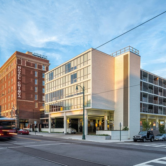 This historic hotel (1913), where Elvis Presley gave his first live radio interview to famed disc jockey Dewey Phillips, was rehabilitated as a Department of Interiors historic rehabilitation tax credit compliant mixed-use project. The attached Chisca annex building (1961) was renovated, and together, the two boast 161 apartment units and ground-floor commercial space.    The project includes a new landscaped urban courtyard along South Main Street; an elevated amenity terrace with outdoor bar area, lounge, and pool; and 140 covered parking spaces in the existing garage, which was also revamped. The renovation of the historic Hotel Chisca and its conversion to a mixed-use building was a uniquely transformative project, presenting the rare opportunity to bridge a major gap in the streetscape between the South Main Historic District and downtown Memphis. The final design celebrates the history of the area by creating a balanced blend between the historic, a modernist addition, and the current revitalization. Ken West Photography