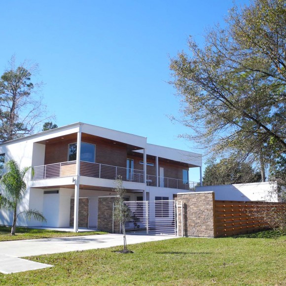 A 3,700 square foot, 2 story, 'Miami' style modern home - very modern and simple, but still has warmth to it.  The stained wood porch ceilings provide a nice contrast to the white stucco exterior.